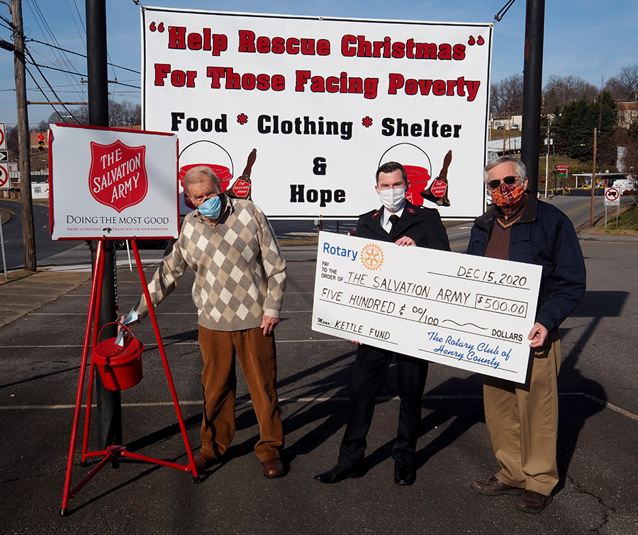 Henry County Rotarians donating $500 to the Salvation Army